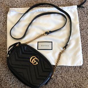 GG Marmont matelassé mini bag in Black